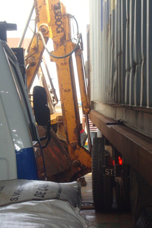 Oops- digger  v  lorry